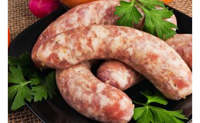 Колбаски из курицы с ветчиной, оливками и рисом